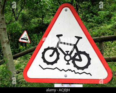 Mountain Bike and car warning signs at Cwmcarn Scenic Drive near Newport South Wales UK - Stock Photo