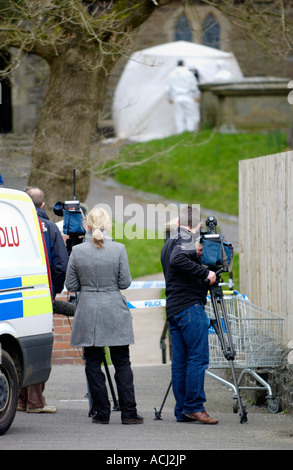 TV news media filming after murder of Father Paul Bennett who was stabbed to death in the grounds of his church - Stock Photo