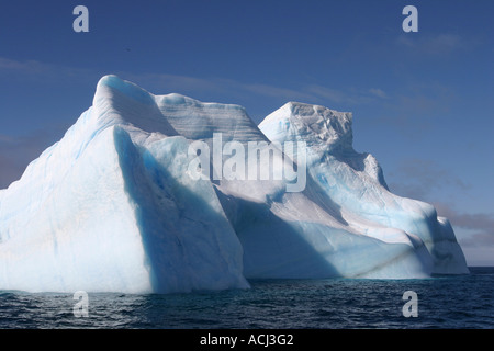 Antarctica Deception Island Blue iceberg floats in calm seas just off Baily Head in South Shetlands - Stock Photo