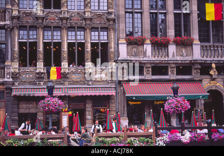 Diners in the old cafes of the Grand Place, Brussels, Belgium. - Stock Photo