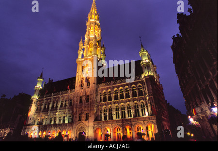 Brussels Town Hall illuminated at dusk, Grand Place, Brussels, Belgium. - Stock Photo