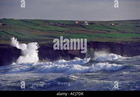 Atlantic waves crashing against the cliffs at Doolin, County Clare, Ireland. - Stock Photo
