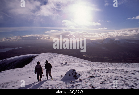 Winter walkers descending from Nephin, Nephin Beg Mountains, County Mayo, Ireland. - Stock Photo