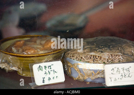 Old noodle display in deserted store - Stock Photo