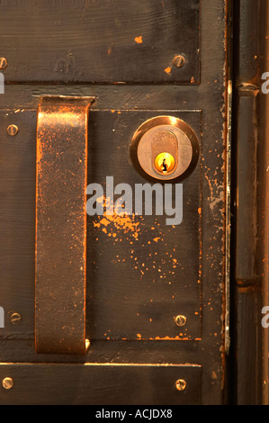 The black solid door with a door handle and lock that leads to and safely secures the wine cellar Ulriksdal Ulriksdals - Stock Photo