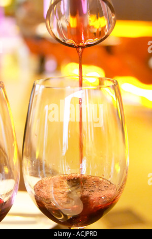 Chakana wine being poured from a decanter to a wine tasting glass. The Restaurant Red at the Hotel Madero Sofitel - Stock Photo