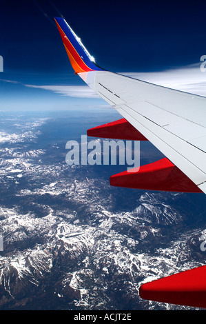 View out the window of an Airplane flying over the snow capped Cascade mountain range. © Craig M. Eisenberg - Stock Photo