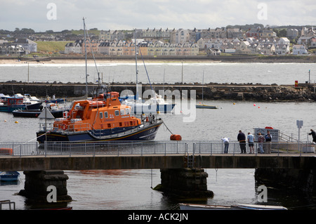 harbour walkway with tourists Portrush lifeboat Katie Hannan Severn class moored in portrush harbour with portrush - Stock Photo