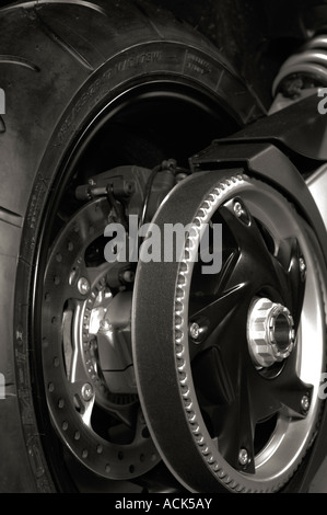 Motorcycle rear wheel and a gear with a belt Bike motorbike details - Stock Photo