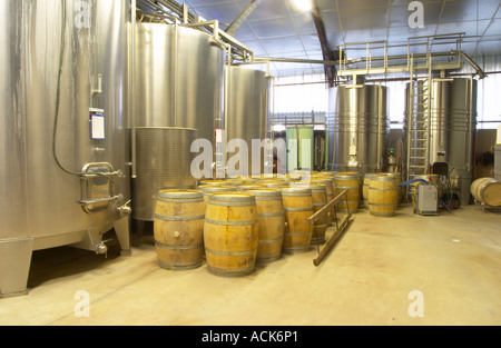 stainless steel fermentation tanks and barriques Chateau Belingard Bergerac Dordogne France - Stock Photo