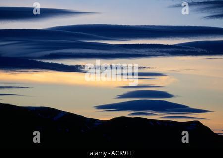 Lenticular Clouds over Isla Navarino, Beagle Channel, Tierra del Fuego, Chile - Stock Photo