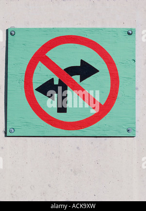 Wooden no left turn or right turn ahead sign - Stock Photo