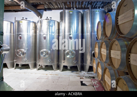 Barrels of wine aging in the cellar stainless steel fermentation tanks Chateau Vannieres (Vannières) La Cadiere - Stock Photo