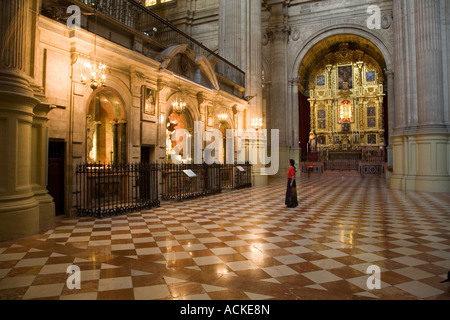 Woman looking at chapels in cathedral Malaga Andalucia Spain - Stock Photo