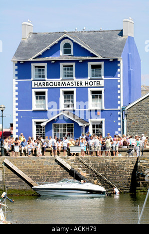 Harbourmaster Hotel on the quayside of Aberaeron harbour on a sunny summers day Ceredigion West Wales UK - Stock Photo