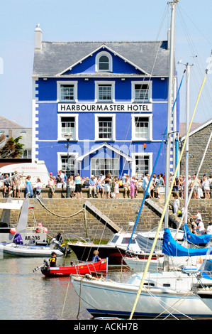 Harbourmaster Hotel on the quayside of Aberaeron harbour on a sunny summers day Ceredigion Wales UK GB - Stock Photo