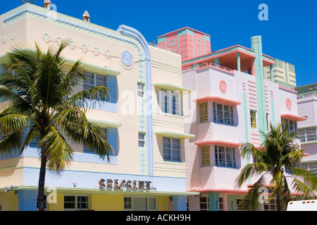 Row of pastel hotels in the art deco architecture style on Ocean Drive in the Art Deco District of South Beach Miami - Stock Photo