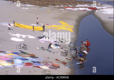 Laundry spread out to dry in the hot sunshine on the sandy banks of the Yamuna River Agra Uttar Pradesh India - Stock Photo