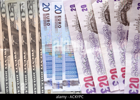 Montage of paper money of different currencies all twenties including british pounds US dollars and euros - Stock Photo
