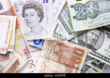 Montage of paper money of various currencies including british pounds US dollars canadian dollars euros and Algerian - Stock Photo