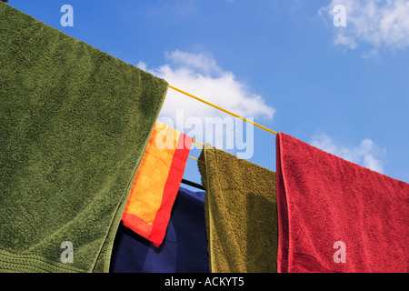 Brightly colored washing on a clothes line - Stock Photo