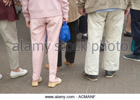senior people standing in a group - Stock Photo