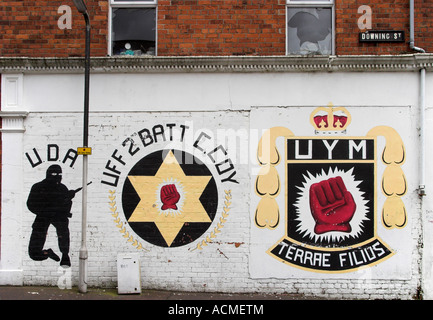UFF and UYM emblems and a silhouette of UDA commando Mural on Downing Street off Shankill Road Belfast - Stock Photo