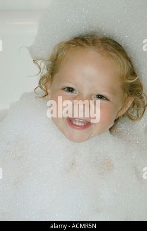 Girl, aged two, in bubble bath : Model Released - Stock Photo