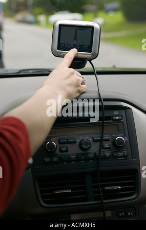 Satellite Navigation System in Automobile - Stock Photo