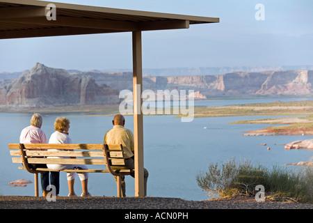 Visitors enjoying the sunset at Lake Powell near Page Arizona part of the Glen Canyon National Recreation Area - Stock Photo