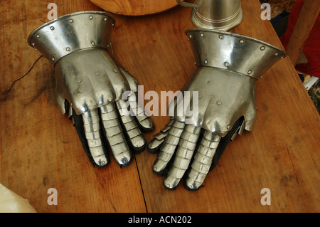 Gauntlet gloves thrown on table 2 two hands shiny polished dsc 1133 - Stock Photo