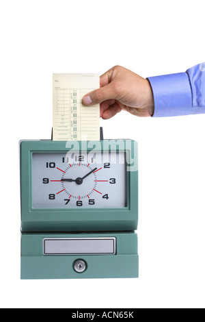 Hand putting card in time clock cut out on white background - Stock Photo