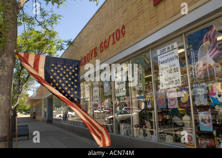 American flag and 5 and 10 cent store in Owosso Michigan USA - Stock Photo