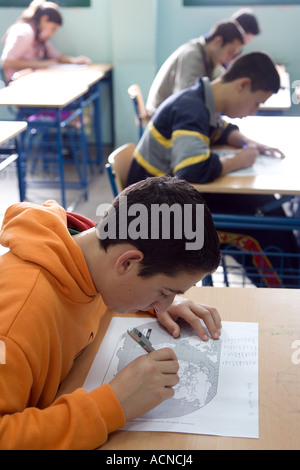 Spanish teenagers taking an examination in their classroom at high school, Spain - Stock Photo