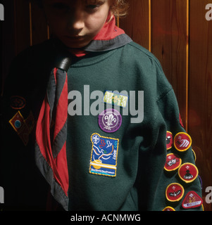 Boy scout with his range of badges for activities completed at the 11th North Leeds troop in Leeds West Yorkshire - Stock Photo