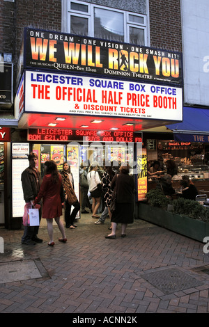 people queuing outside leicester square discount ticket booth in the early evening london england uk - Stock Photo
