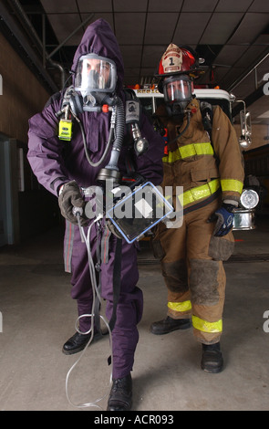 Firefighter with biohazard emergency gear mask and suit - Stock Photo
