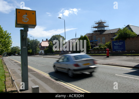 Speed camera with dollar sign. - Stock Photo