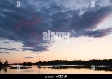Sweden Stockholm archipelago boating among idyllic islands moored boats at dusk summer 2007 - Stock Photo