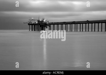 Long exposure at night of the Scripps Pier in La Jolla - Stock Photo