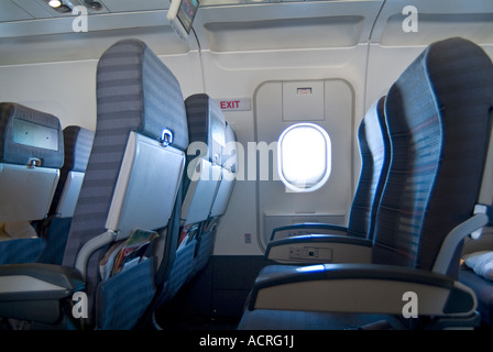 Empty Airplane Seats And Window On Commercial Airline Flight - Stock Photo
