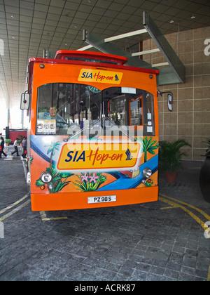 SIA Hop-On tourist bus Singapore - Stock Photo