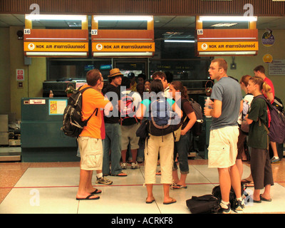 Passengers queue to check in at Nok Air desks Phuket airport Thailand - Stock Photo