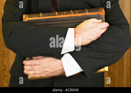 Man holding large book - Stock Photo