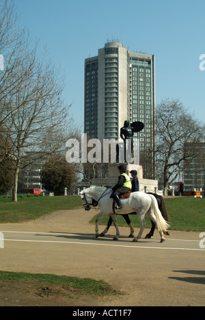London Hyde Park horses being exercised Hilton Hotel in Park Lane statue of Achilles commemorating Duke of Wellington - Stock Photo