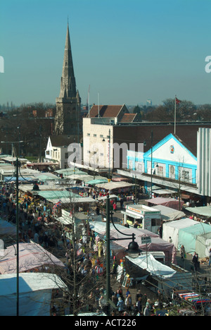 Historical aerial birds eye winter view looking down on urban landscape stalls & shoppers in Romford market place - Stock Photo