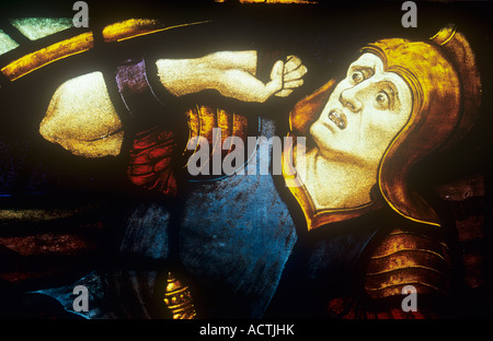 Late Victorian stained glass window depicting a horrified or awestruck Roman soldier cowering below crucifixion - Stock Photo