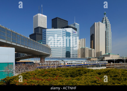 VIA train at Union Station skywalk and Toronto highrise skyline with financial towers - Stock Photo