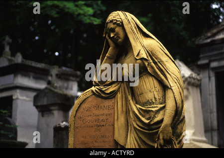 A tombstone in the famous Paris Cemetery Pere Lachaise, home to the graves of many giants of French and world culture. - Stock Photo