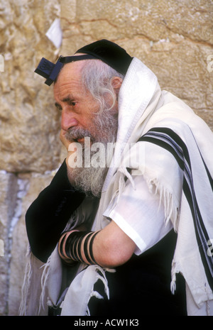 An orthodox Jew at the Western Wall in Jerusalem, Israel. - Stock Photo